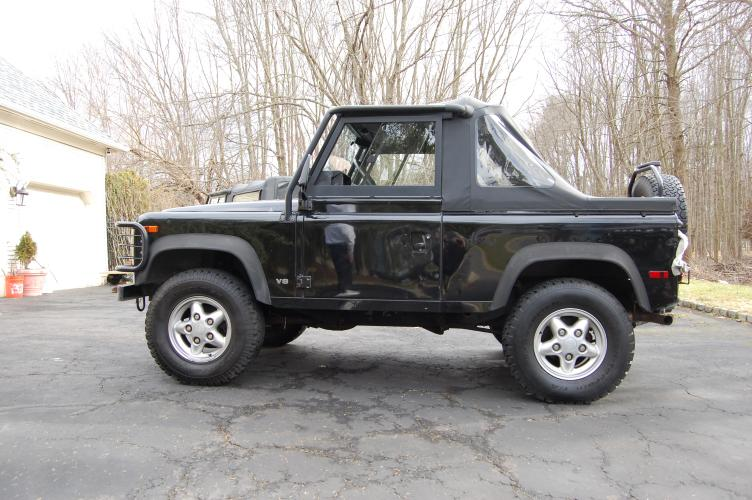 1995 Black /Black Land Rover Defender 90 2-Door 4WD (SALDV2280SA) with an 3.9L V8 OHV 16V engine, 5-Speed Manual Overdrive transmission, located at 6528 Lower York Road, New Hope, PA, 18938, (215) 862-9555, 40.358707, -74.977882 - Photo #0
