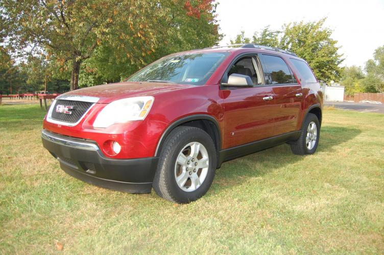 2010 Grenada Red /Black GMC Acadia (1GKLRLED2AJ) with an 3.6L V6 DOHC 24V engine, 6-Speed Automatic Overdrive transmission, located at 6528 Lower York Road, New Hope, PA, 18938, (215) 862-9555, 40.358707, -74.977882 - Photo #0