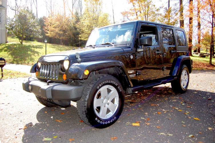 2007 Black /Gray Jeep Wrangler Unlimited Sahara 4WD (1J4GA59177L) with an 3.8L V6 OHV 12V engine, Automatic transmission, located at 6528 Lower York Road, New Hope, PA, 18938, (215) 862-9555, 40.358707, -74.977882 - Photo #0